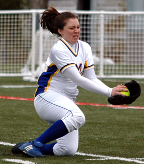 Nicole Poland of the Mariners makes a diving catch in centerfield.—MIKE OLES